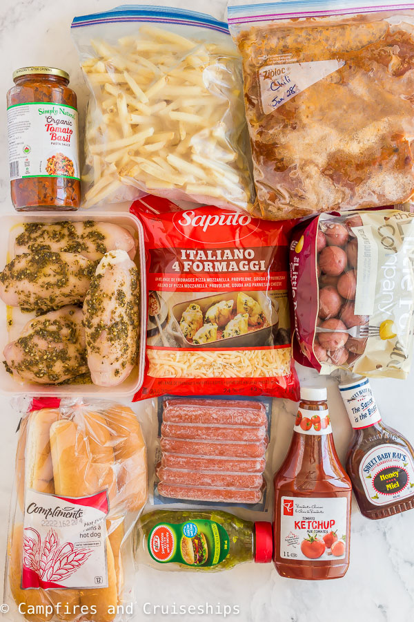 camping dinner ideas ingredients including chicken breasts hot dogs frozen chili and fries