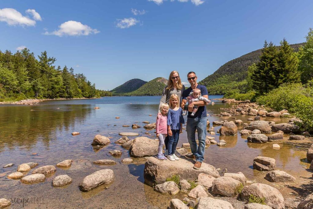 family photo at jordan pond standing on rocks in the water