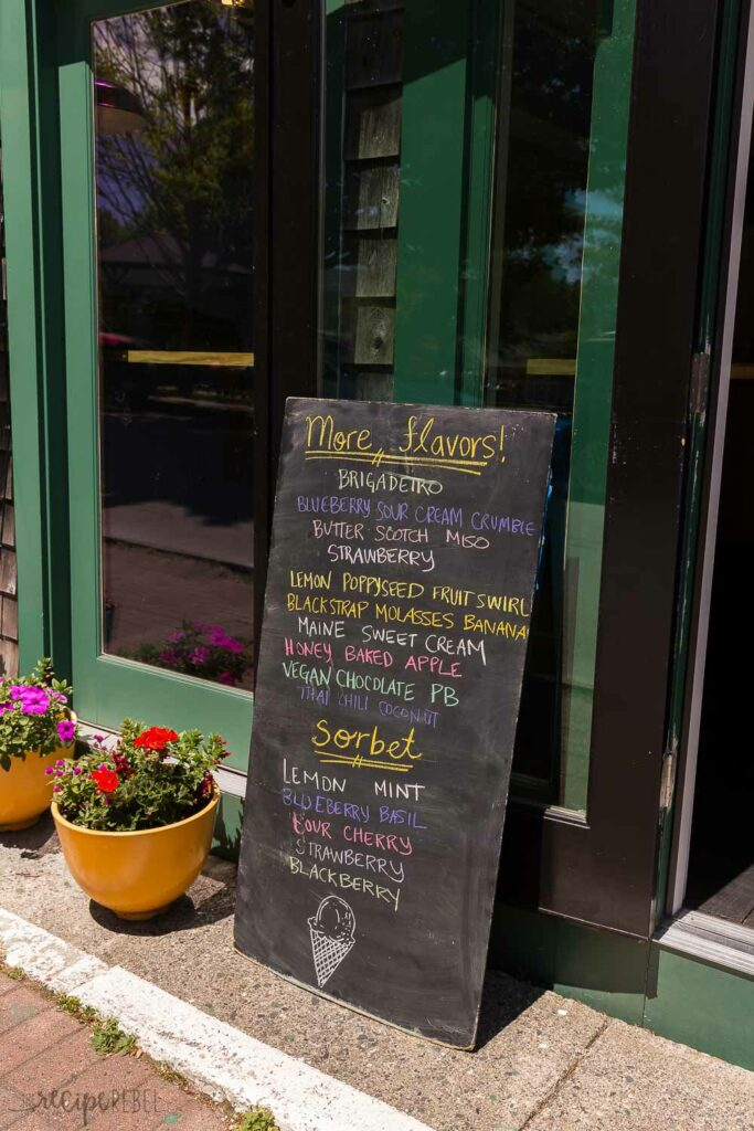 mount desert island ice cream exterior with sign listing flavors