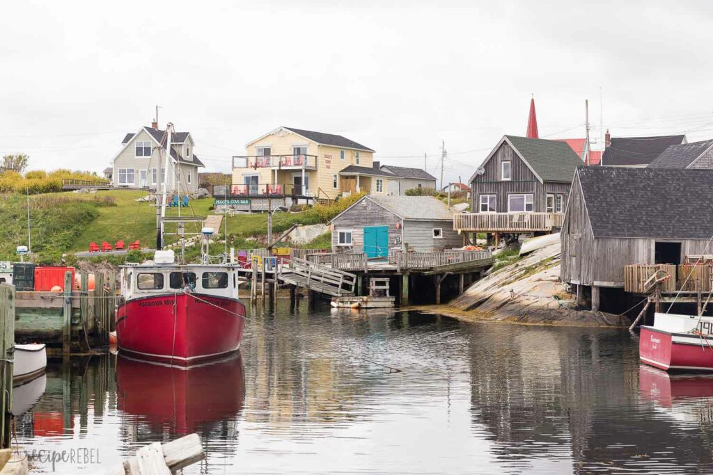 peggy's cove nova scotia with fishing boats and shacks
