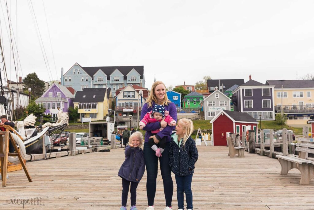mom and three daughters on the dock in lunenberg