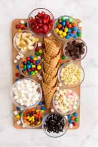 campfire cones board with waffle ice cream cones marshmallows and candies