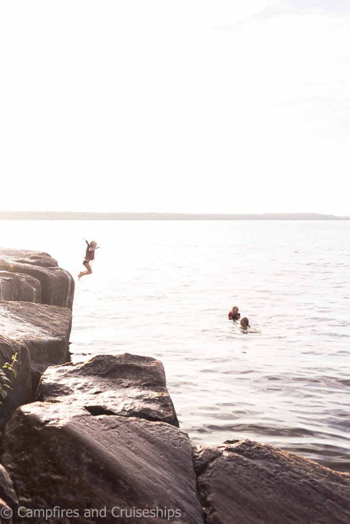cliff jumping at blueberry hill at nutimik lake manitoba
