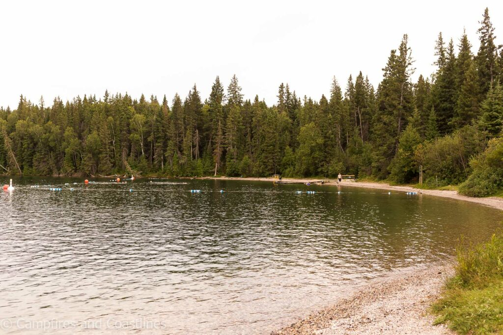deep bay beach in clear lake riding mountain national park